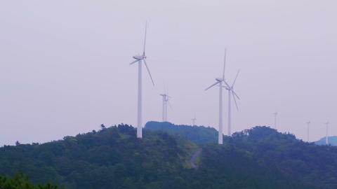 Long Panning Shot Of A Japanese Wind Mill stock footage