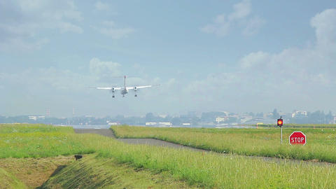 Twin Prop Plane Landing From Behind stock footage