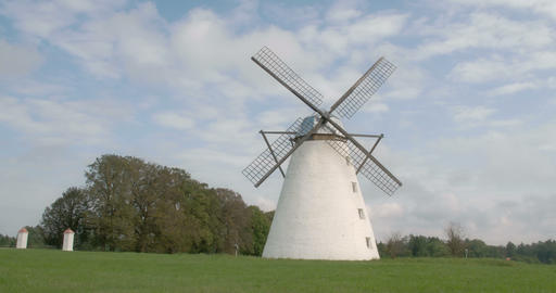 A classic old windmill in the middle of the field Footage