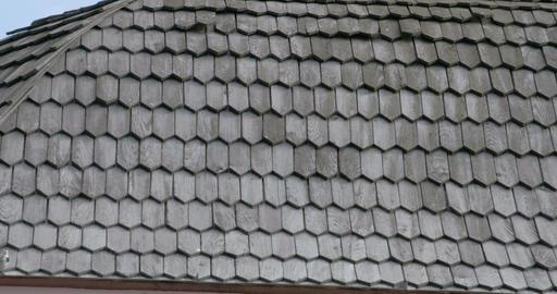 Black cedar wooden shingle roofs of a house FS700 Footage