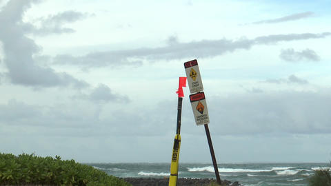 warning sign strong current at hawaii beach on big Live Action