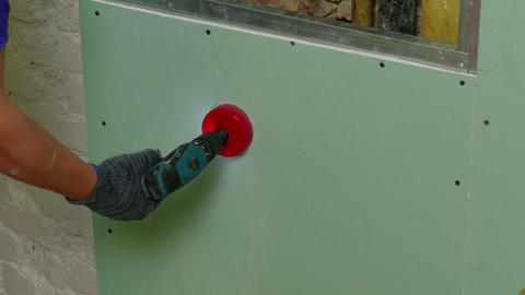 Repairer Make Drilling a Round Hole in a Drywall Footage