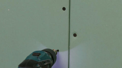 Repairer Make Install Drywall using Screwdriver an Footage