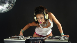 female dj dancing and playing records 4k Footage