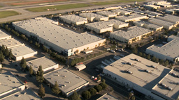 1080 Aerial Warehouse 1 PJPEG stock footage