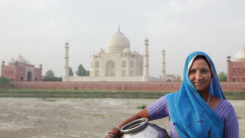 Indian Woman wearing Sari in front of Taj Mahal Stock Video Footage