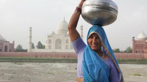 Indian Woman wearing Sari in front of Taj Mahal Stock Video Footage