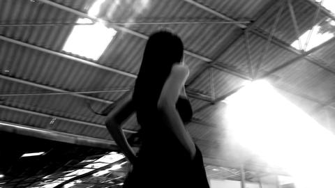 sexy beautiful girl dancing woman black dress warehouse high heels red rose walking Footage