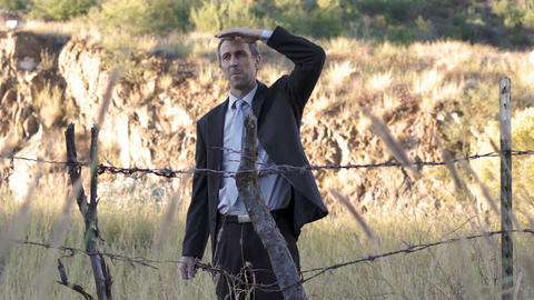 Businessman Barbed Wire Fence Look Around stock footage