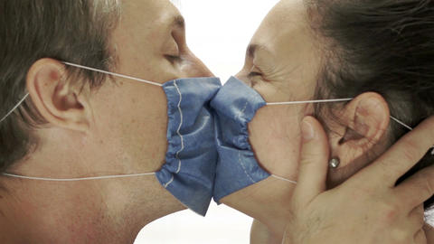 Couple Wearing Medical Masks Kissing stock footage