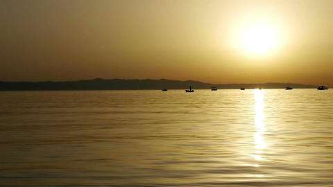 Small Boats At Sea In Sunset stock footage