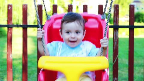 Baby boy in a swing 1 Footage