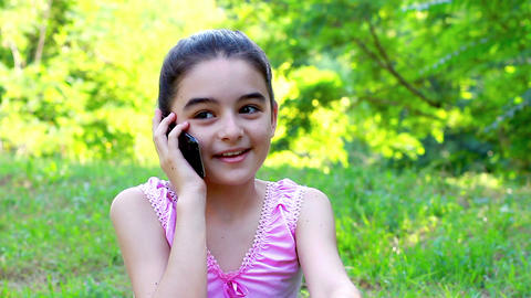 Beautiful Smiling Teenage Girl Talking On Mobile stock footage