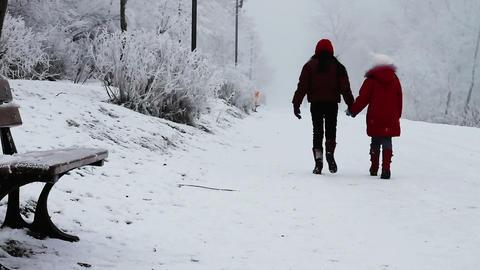 Children walking in snow Footage