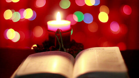 Christmas candle and Bible Footage
