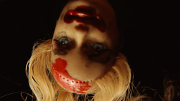 Cursed doll appearing upside down close up 1 Footage