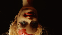 Cursed doll appearing upside down close up 2 Footage