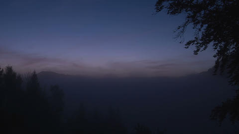 Moving fog in the valley in Alps at sunrise, Germa Footage