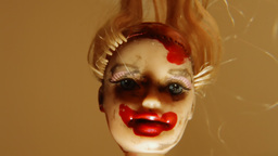 Cursed doll face back front close up Footage