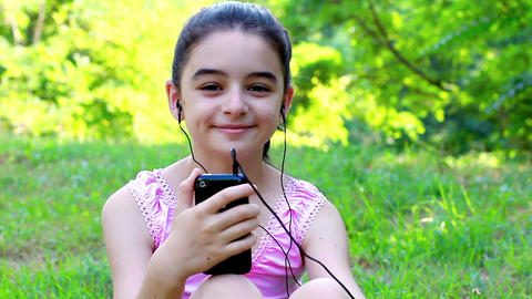 Girl listening to music on a smartphone 1 Footage