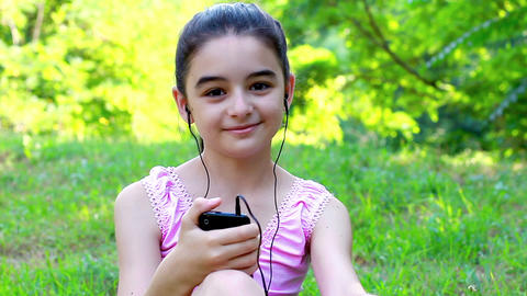 Girl listening to music on a smartphone 2 Footage