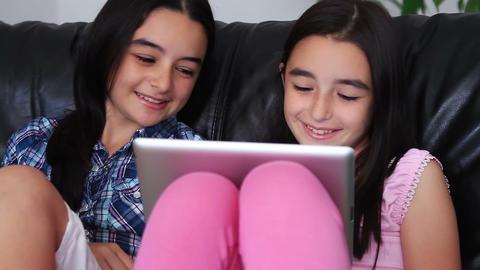 Happy teenage girls using tablet computer Footage