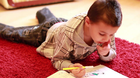 Little Boy Coloring 2 stock footage