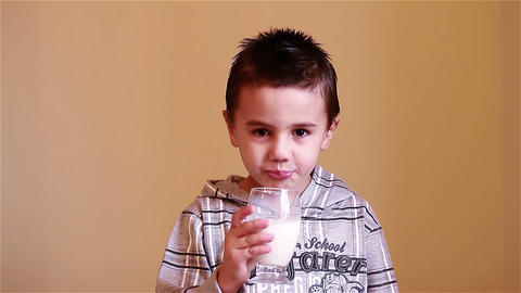 Little Boy Drinking Milk stock footage