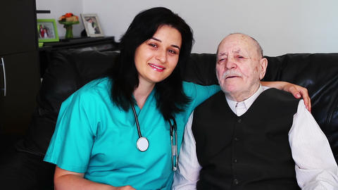 Nurse giving care to a senior man Footage