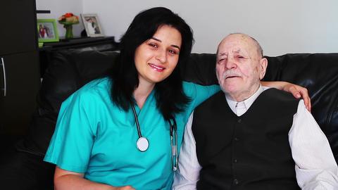 Nurse giving care to a senior man Footage