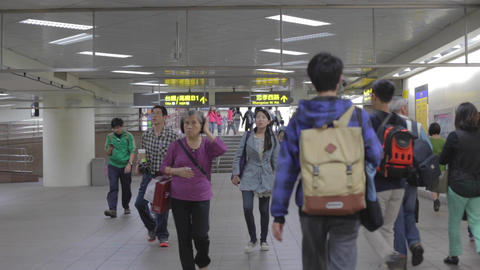 people walking at Taipei main station Live Action