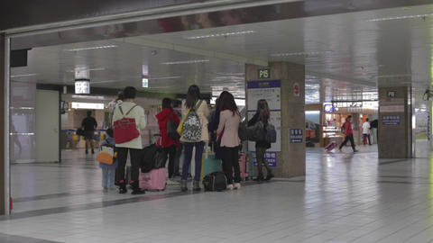 group of Asian tourists at Taipei main station Live Action