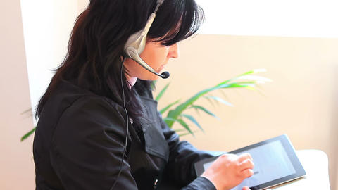 Receptionist on the phone with tablet computer 1 Footage