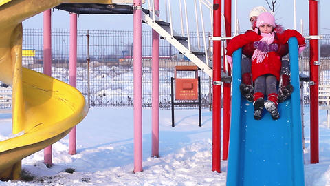 Sisters playing in the park in winter Footage