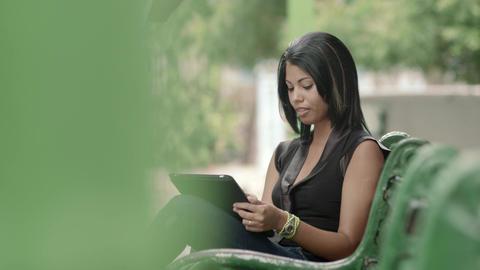 Beautiful Young Hispanic Woman Typing On iPad Digital Tablet Footage