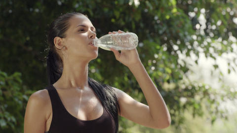 Female Friends Relaxing And Drinking Water After Exercise Footage