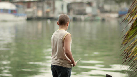 Youth Fun With Young Boy Fishing On River During S stock footage