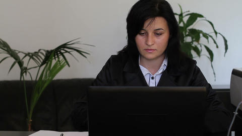 Young businesswoman working on laptop Footage