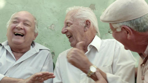 Active retirement, group of three old male friends Live Action