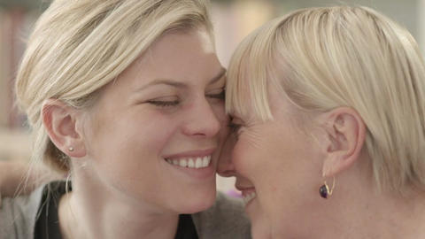 Family portrait of happy mom and daughter smiling, hugging Footage
