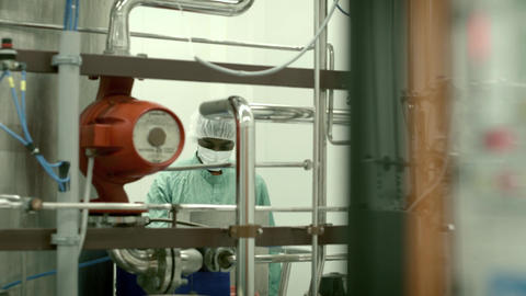 Lab technician working as researcher in biotechnology plant with equipment, mach Footage