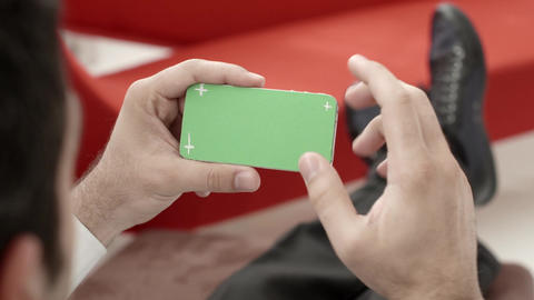 Man Typing On Smartphone With Green Screen stock footage