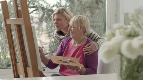 Family portrait with happy mother painting for hobby Footage
