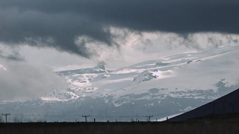 Dark Dramatic Sunset Over Snowy Mountains stock footage