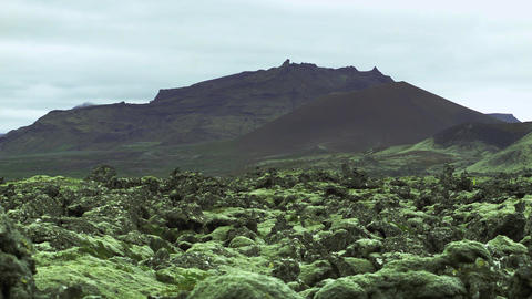 Rocky Landscape Below Volcanic Mountains stock footage