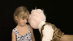 Little girl puppet sad play Footage