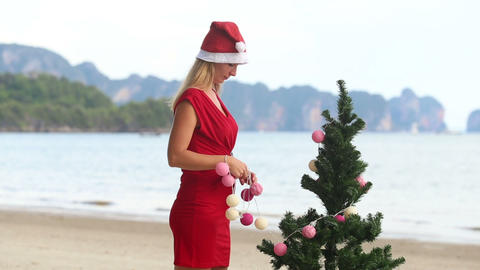 girl in a red dress and a Christmas cap Footage