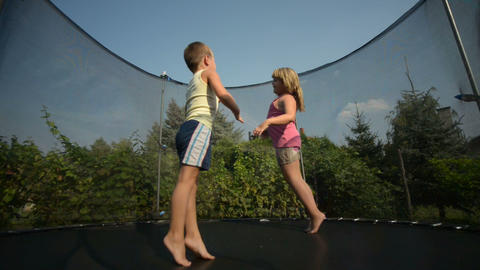 Children enjoy jumping on trampoline Footage