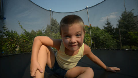 Boy enjoy jumping on trampoline Footage