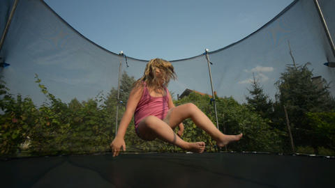 Happy girl jumping in the trampoline Live Action